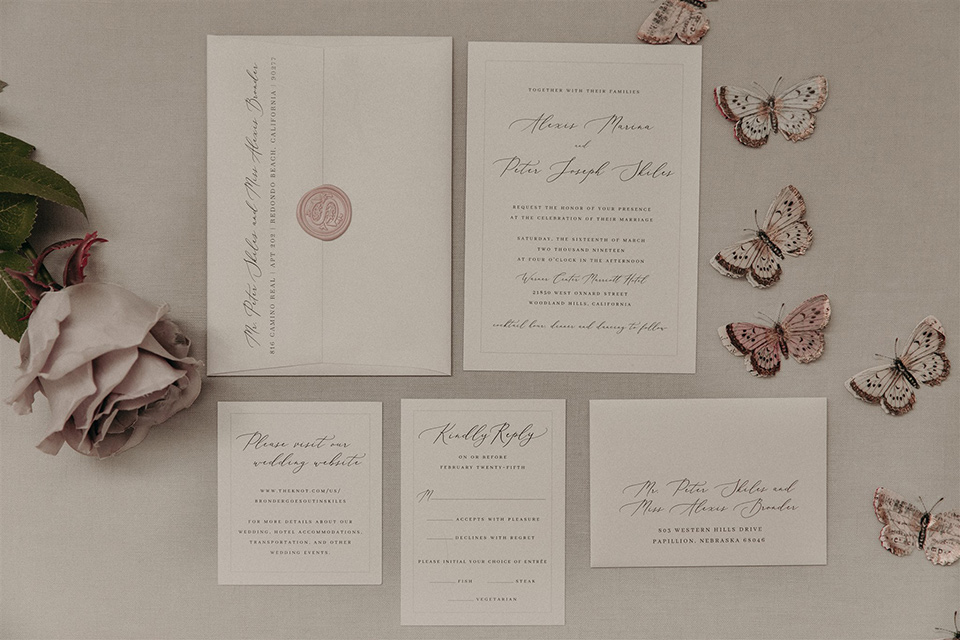 white invitations and mauve colored cursive