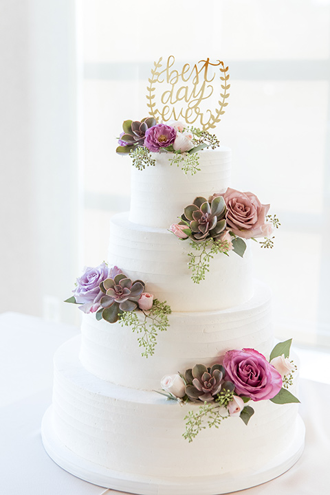 white cake with pink and lilac flowers