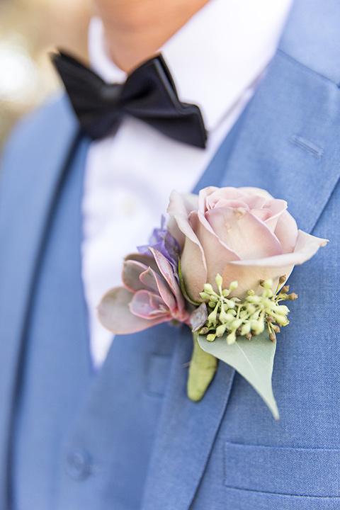 light blue notch lapel suit with a navy bow tie