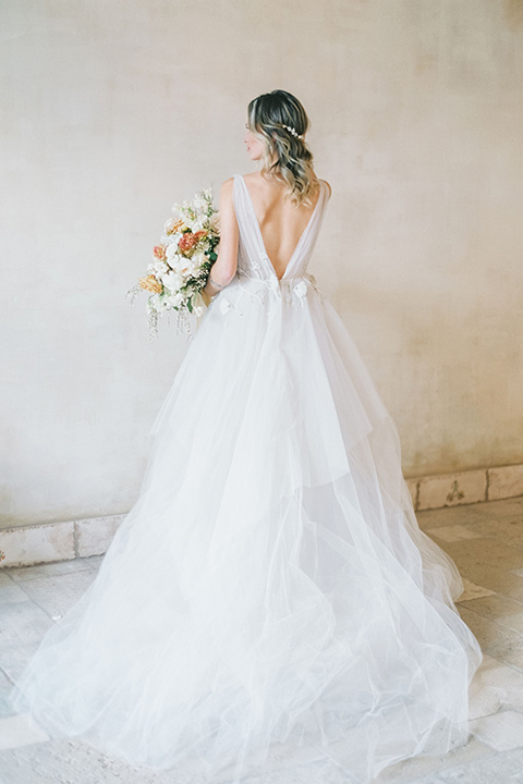 bride in a white ballgown with a low back detail