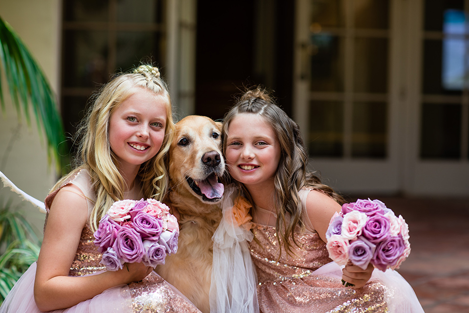 the flower girl with the golden retriever