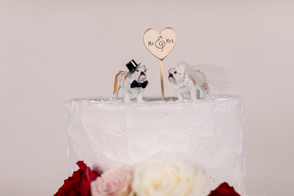cake topper with English bull dogs in bride and groom wear
