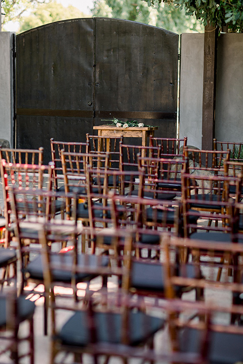 deep brown wooden chairs at the ceremony