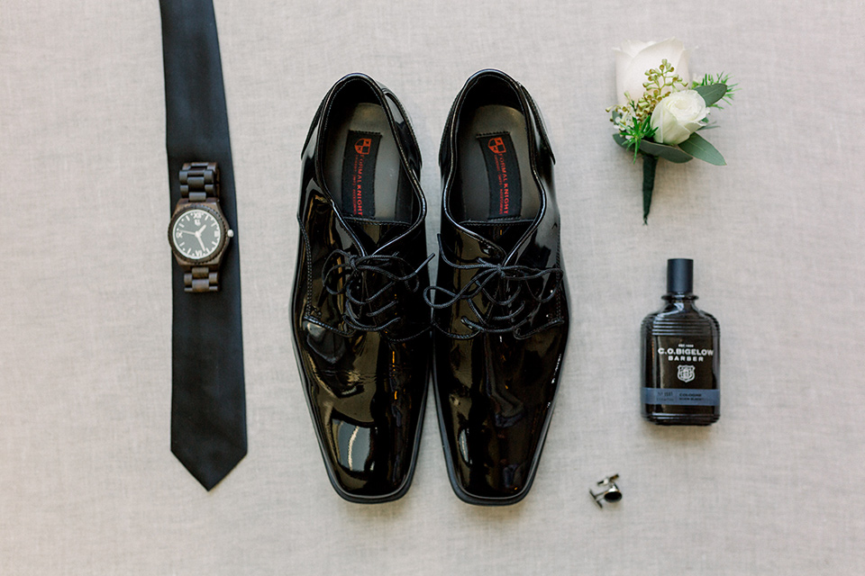 black tuxedo shoes with a black long tie and watch