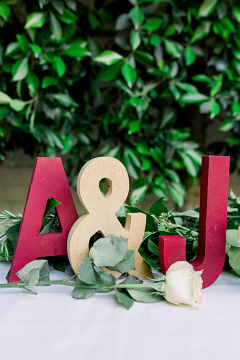 gold and red initials on sweetheart table
