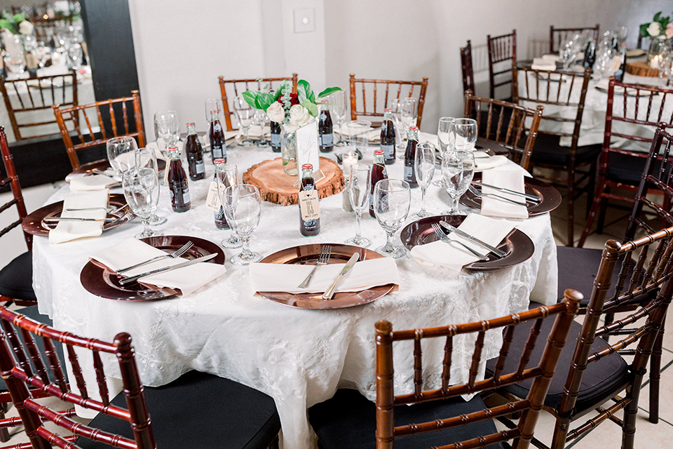 wooden table with white linens and wooden chairs