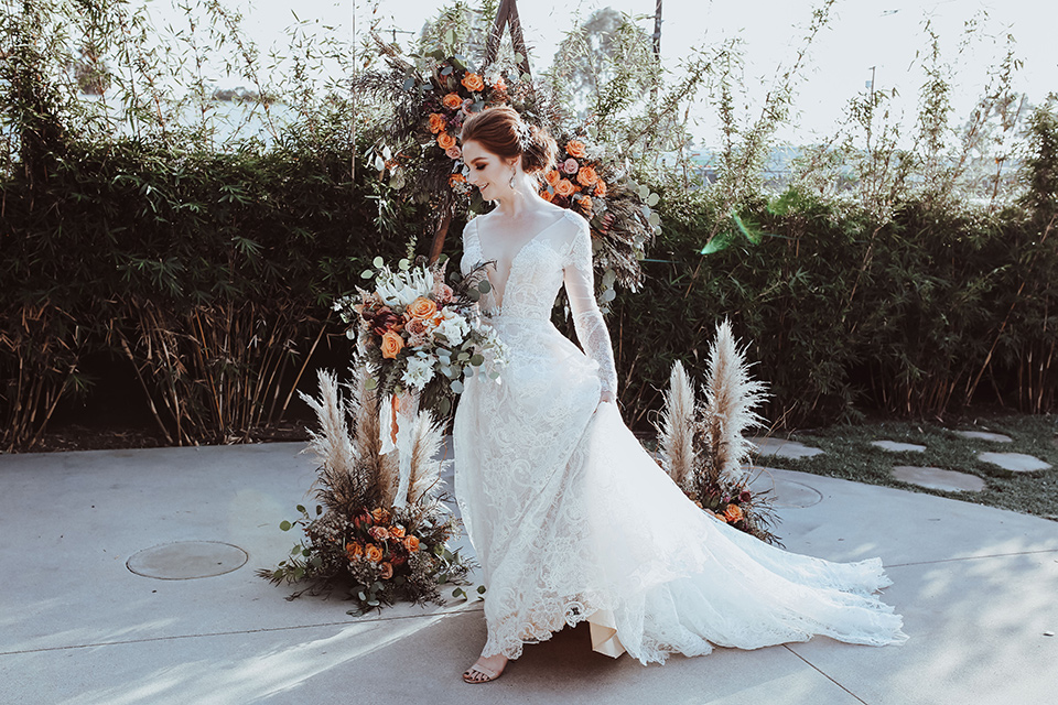 bride in a white gown with a flowing skirt and a lace high neck gown