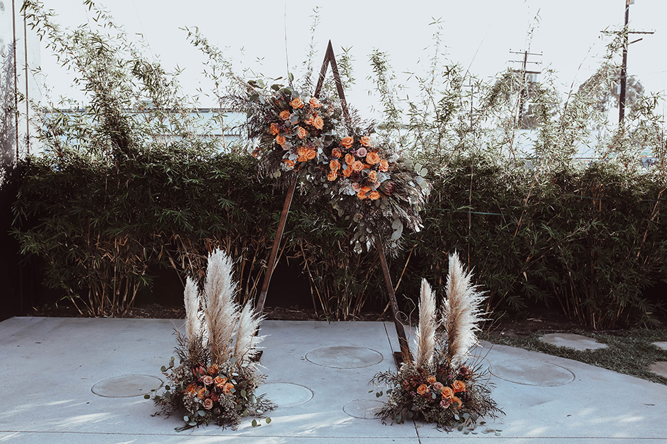 geometric arch with pampas grass and boho style flowers