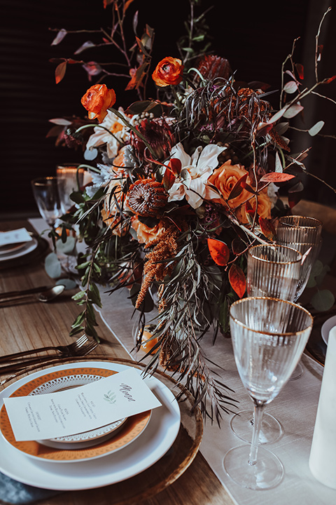 white and terracotta plates with autumn boho style flowers