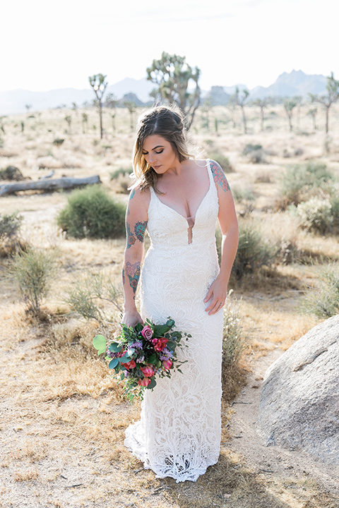 bride in a white lace bohemian style gown with a sweetheart neckline and thin straps
