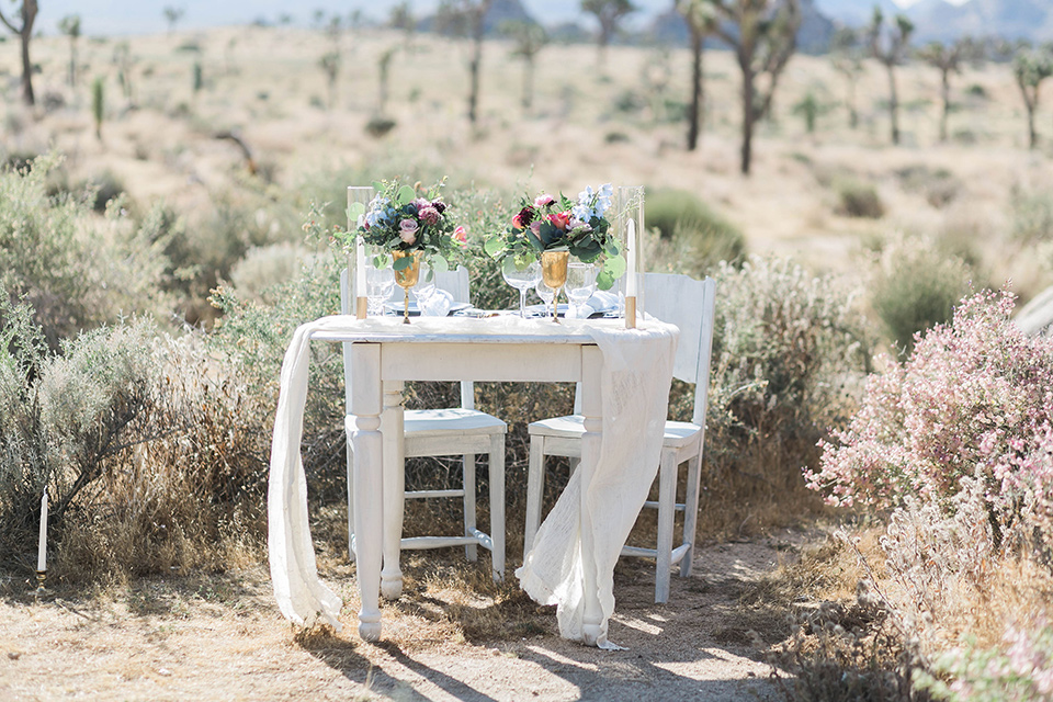 sweetheart table with bohemian touches and lace linens
