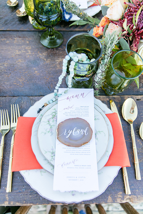 flatware with white plates and gold flatware
