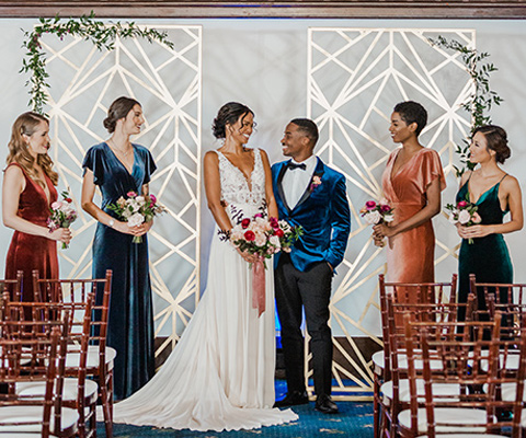bridesmaids-in-velvet-gowns-and-groom-in-velvet-tuxedo