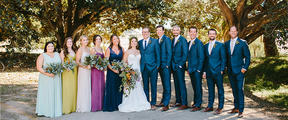 gem-colored-gowns-and-groomsmen-in0dark0navy-suits