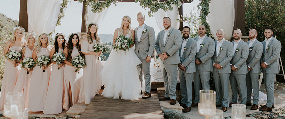 light-blue-bridesmaids-gowns-and-the-men-in-grey-suits