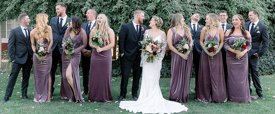 mauve-purple-velvet-bridesmaid-gowns-and-groomsmen-in-black-suits