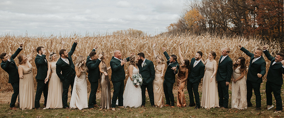 neutral-champagne-and-gold-bridesmaids-gowns-and-groomsmen-in-grey-suits