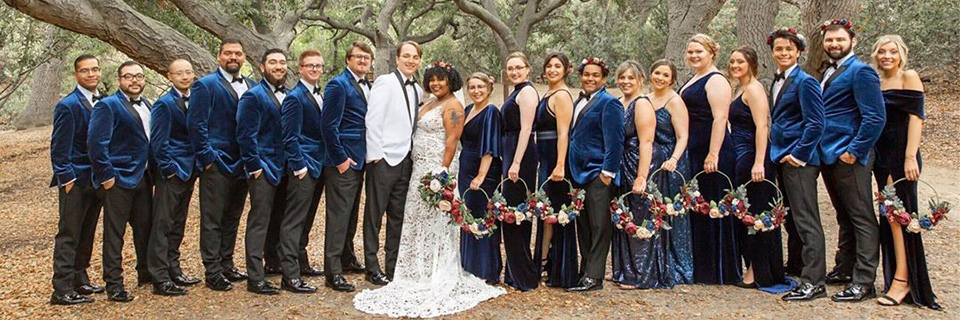 teal-blue-bridesmaids-gowns-with-blue-suits-for-groomsmen-and-grey-suit-for-the-groom