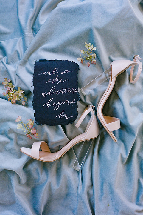 rose gold heels and deep navy menu card