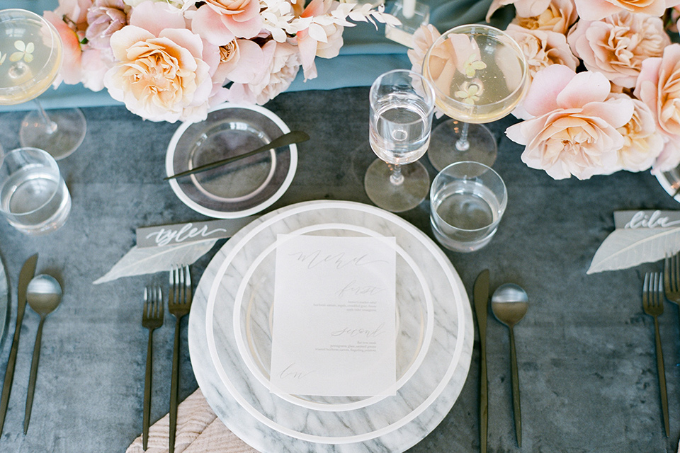 dusty blue linens and white and gold flatware