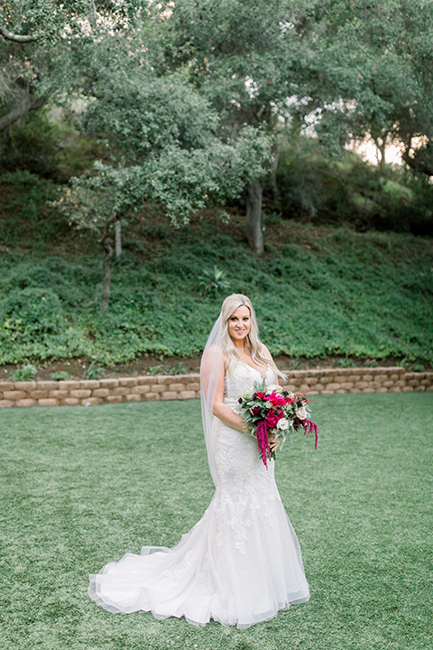 bride in a white lace mermaid style gown and a strapless neckline