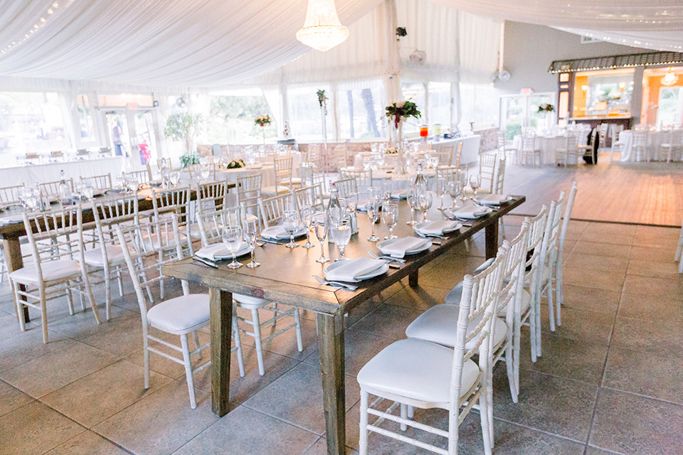 reception tables with white linens and farmhouse tables