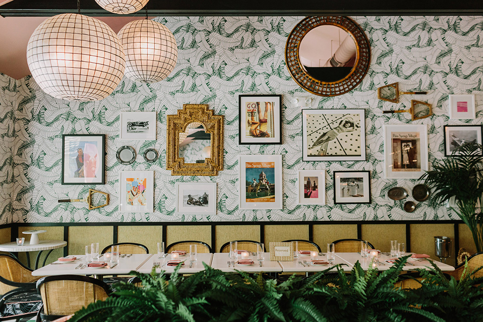 eclectic venue setting with fun wallpaper and art on the walls