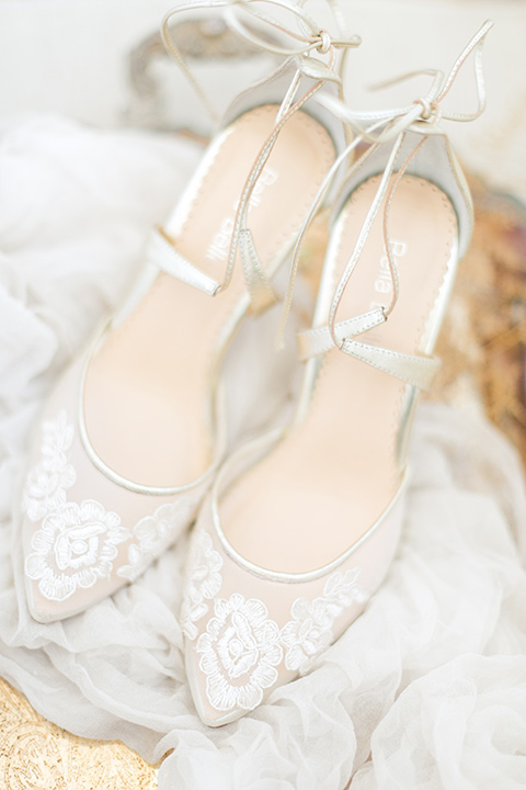 white and crystal bridal shoes with an ankle strap