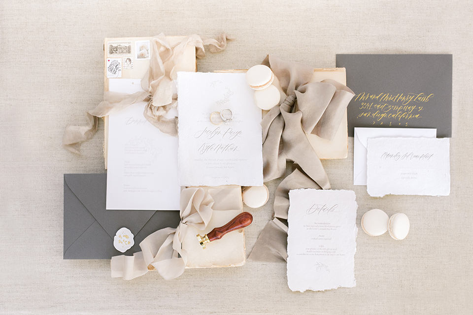 bride the white invitations with grey envelopes