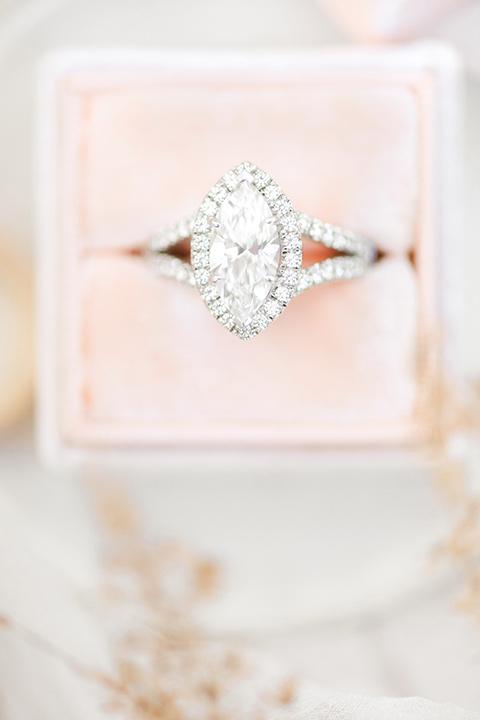 blush pink velvet ring box with a diamond ring