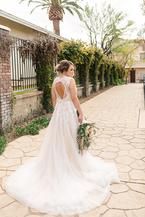 bride in a lace gown with a high neckline