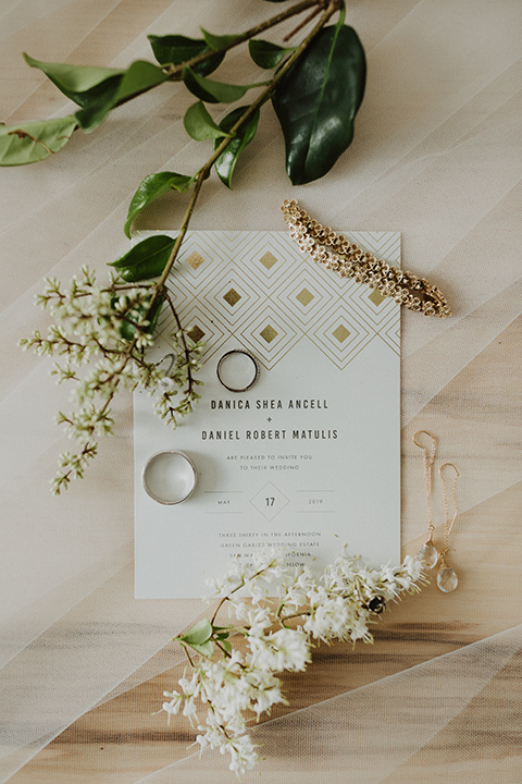 white invitations with rings