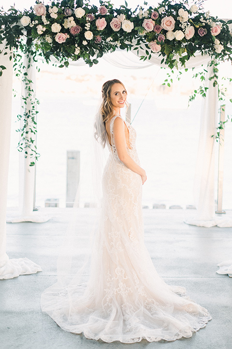 bride in an ivory lace gown with a modern geometric pattern and a v neckline