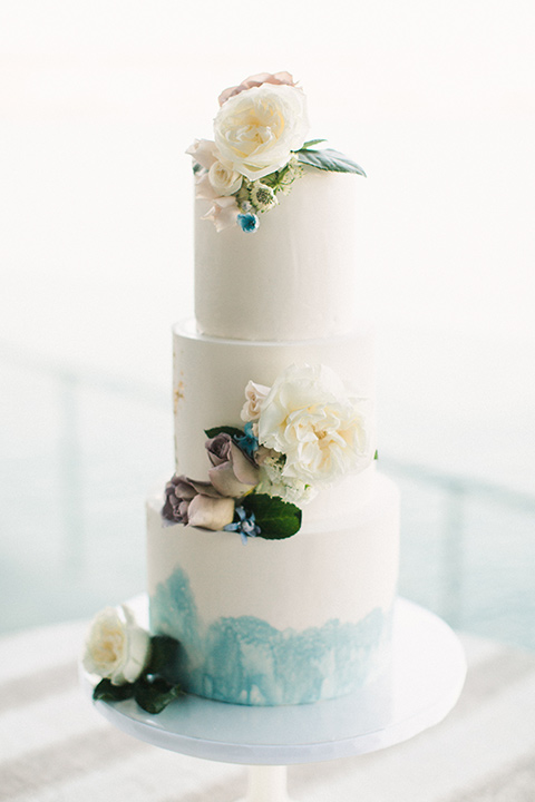 white and blue ombre cake with white floral design