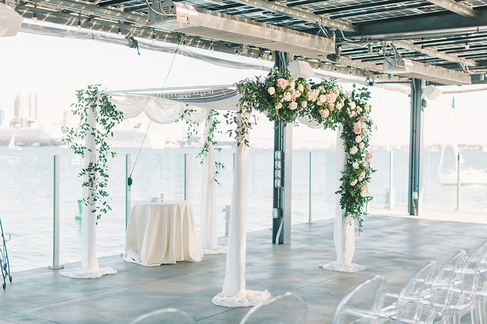 ceremony space with white and clear details and ceremony arch
