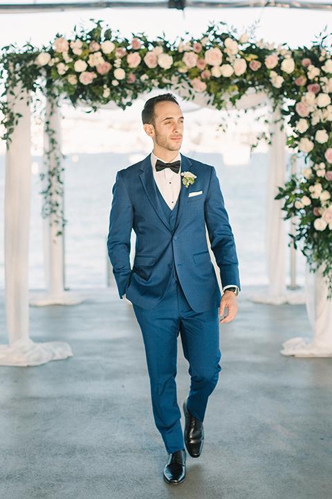 cobalt blue suit with a black bow tie