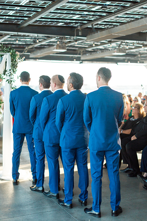 groomsmen in cobalt suits at the ceremony