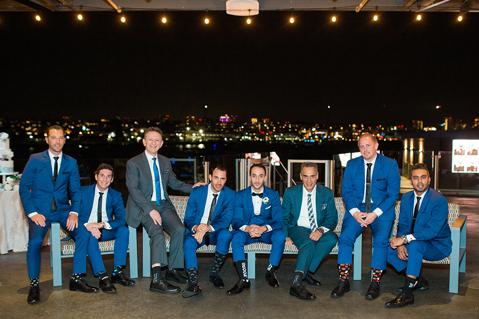 groom and groomsmen in cobalt blue suits with black bow and long ties