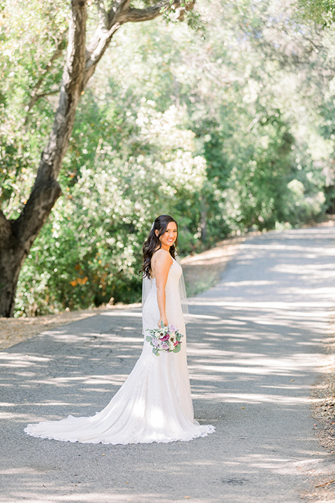 bride in a white gown with lace and thin straps