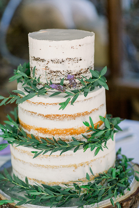 tiered natural iced cake with green florals