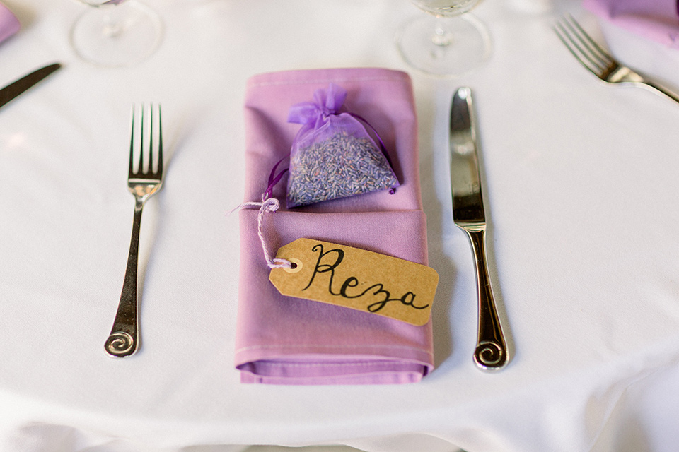 purple linens and gold flatware at the reception