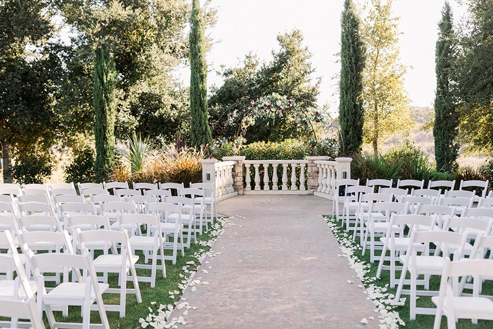 white chairs and white gazebo wedding ceremony decor