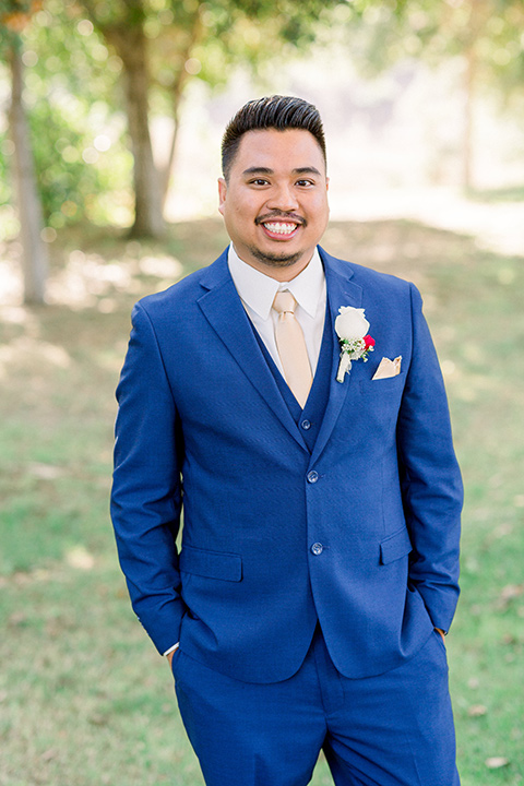 groom in a cobalt blue suit with a pink long tie