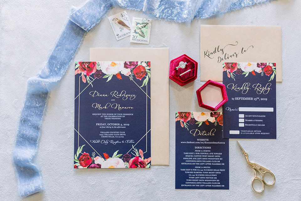 royal blue invitations with pink and red flowers