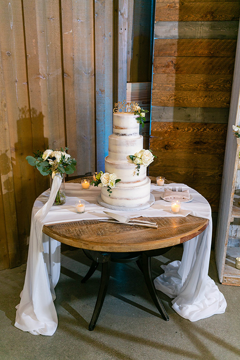 cake with white icing and white florals