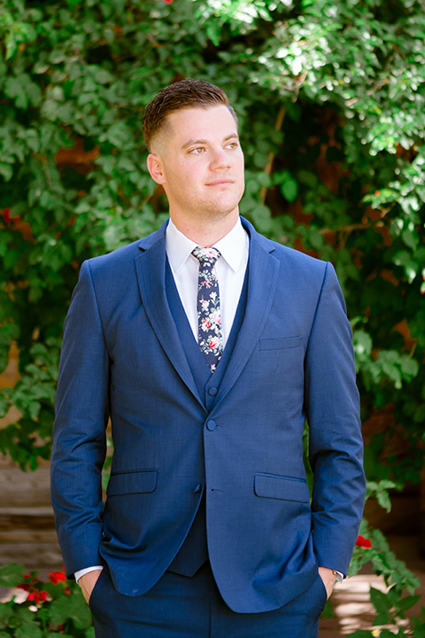 groom in a cobalt blue suit with a blue floral long tie