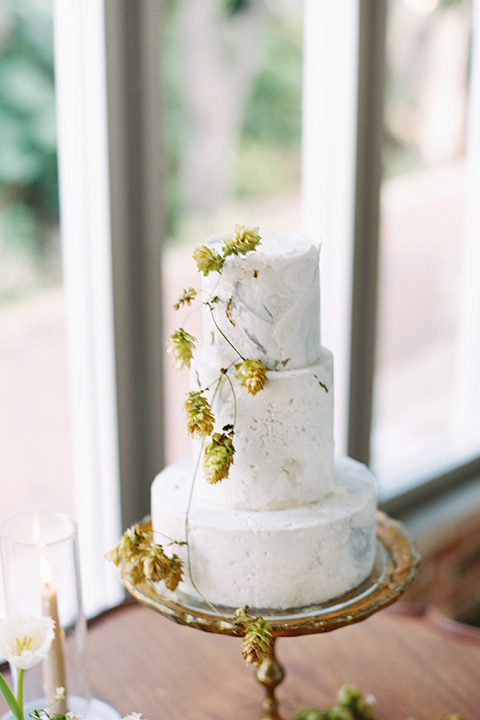 white cake with gold flower details