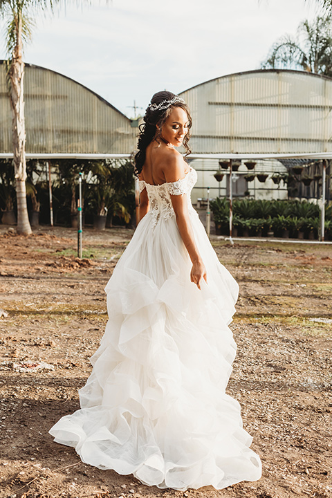 bride in a lace ballgown with off the shoulder neckline