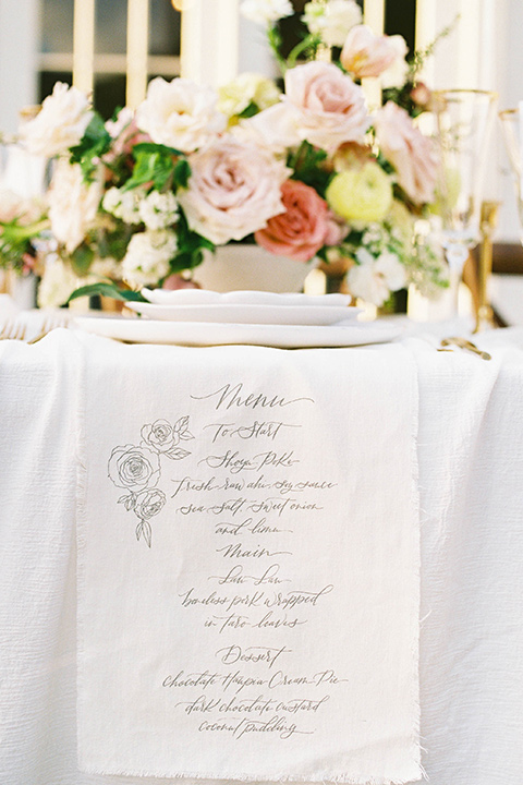 table with linens and florals