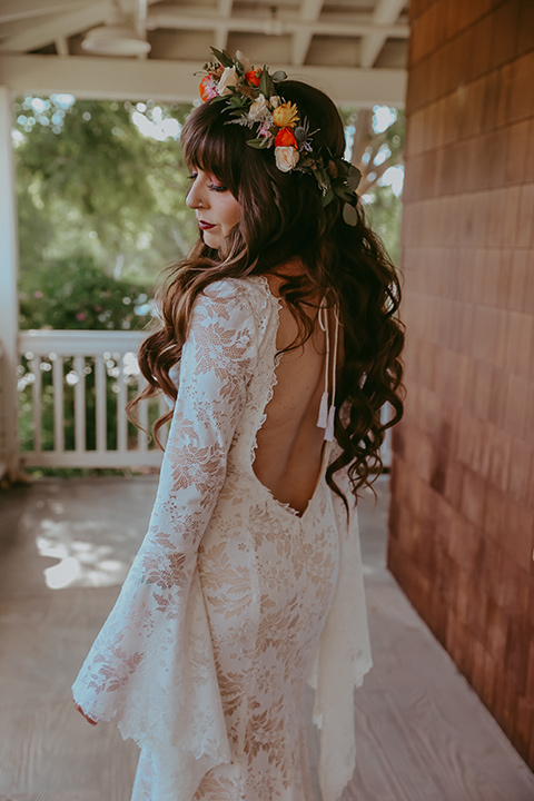 bride in a lace bohemian gown with tulip sleeves and a braided crown
